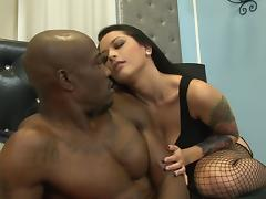 A fishnet wearing babe enjoys black cock during an interracial hook up