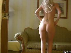 A stunning teen blonde dances naked on her home webcam