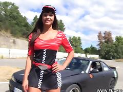 A race car loving girl drives his car then rides his cock