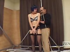 Lingerie clad brunette enjoys a little torture in a kinky bdsm fetish clip