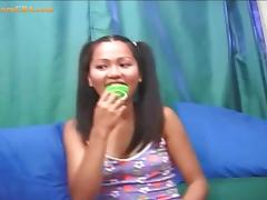 Asian lollipop girl shows her hairy pussy