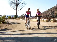 Two bike-riding babes stop to have a nice little lesbian adventure