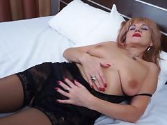 Moans as mature blonde in stockings ravishes her pussy with toy