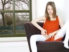 Skinny vagina teasing on the armchair