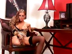 Ava Blue the luscious babe masturbates sitting in the armchair