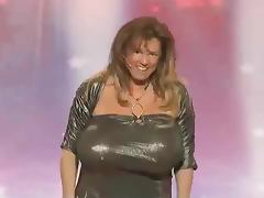 Woman crushes objects with her giant Boobs