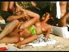 Brunette Springbreak Gangbang on a Beach