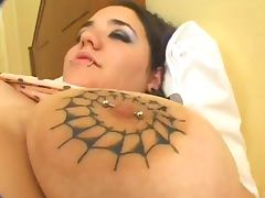 chubby brunette with tatoos on tits in anal action