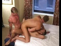 Three tattooed men fucking bareback and eating cum.