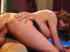 Brunette's wet pussy gets pierced by two cocks