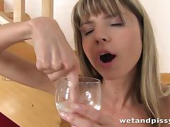 cute blonde plays with her piss