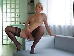 Pretty pornstar Sweet Cat is showing off in her lingerie