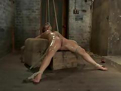 Baylee Lee enjoys being tormented in a cellar in BDSM scene