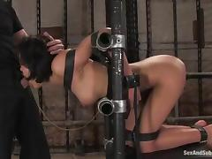 Ruby Knox gets her pussy drilled while being chained in a pillory