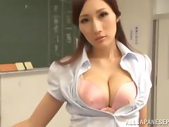 Tempting Asian teacher Julia gets her huge tits fucked