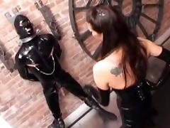 Latex Dominatrix with strap on