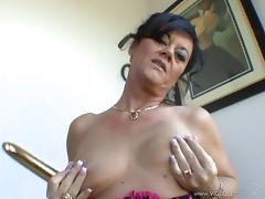 Mature De'bella is fucked by two large cocks in a threesome