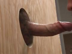 Swallowing a cock through the gloryhole