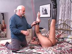 Brunette slut gets her  nipples pinched while she bounded and gagged