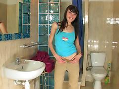 Breathtaking solo model teen masturbating passionately in the toilet