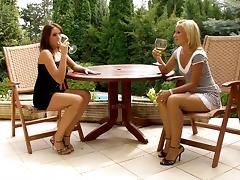Gorgeous lesbians enjoy some wine and some outdoor pussy licking